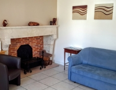 Guest lounge with original fireplace